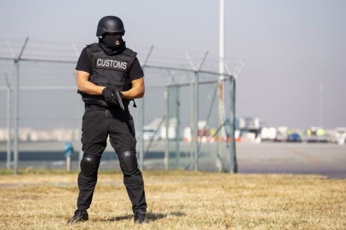 Customs and border protection officer participates in a training at the airport.