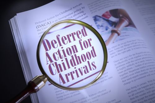 Deferred Action for Childhood Arrival on a page with magnifying glass