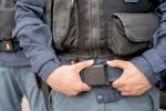Photo of the midsection of police forces uniform