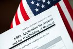 Application for asylum to USA concept with application form and USA flag